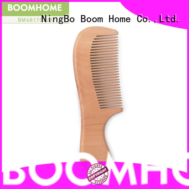 Boom Home brushes wooden comb company for hotel