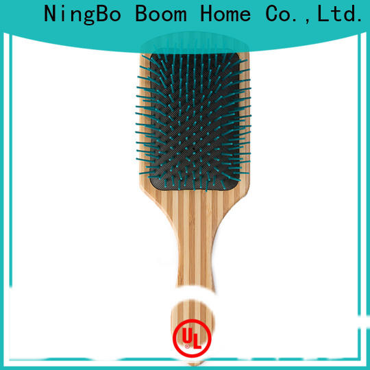 Boom Home brands wooden paddle brush company for travel